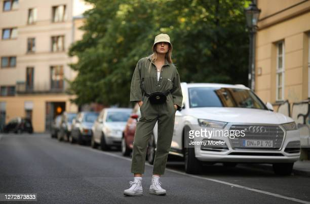Alessa Winter wearing olive overall, Holzweiler bucket hat, Gucci belt bag and Converse sneaker on September 12, 2020 in Berlin, Germany.