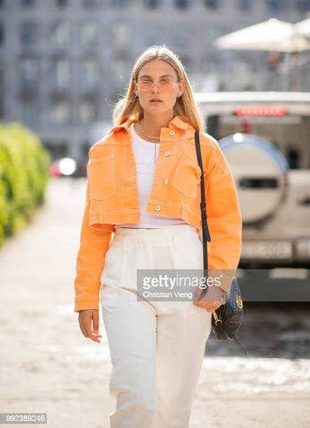 Alessa Winter wearing orange cropped denim jacket is seen outside Lana Mueller during the Berlin Fashion Week July 2018 on July 5, 2018 in Berlin,...