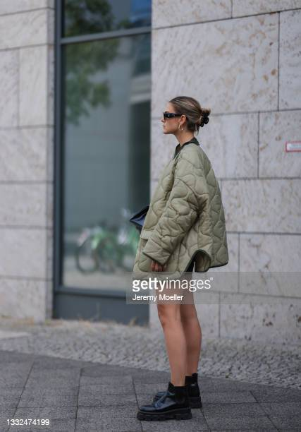 Alessa Winter wearing Prada black shades and black boots, the Frankie Shop olive jacket and Balenciaga black bag on August 03, 2021 in Berlin,...