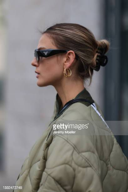 Alessa Winter wearing Prada black shades and the Frankie Shop olive jacket on August 03, 2021 in Berlin, Germany.