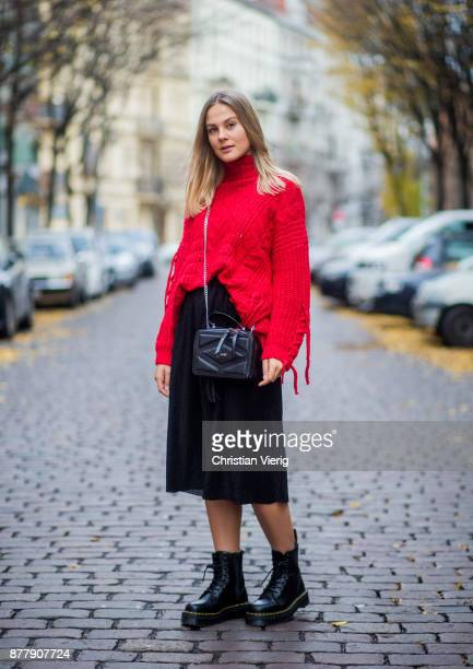 Alessa Winter wearing red knit Bershka black Laurel bag black midi skirt Naked black Dr Martens boots on November 23 2017 in Berlin Germany