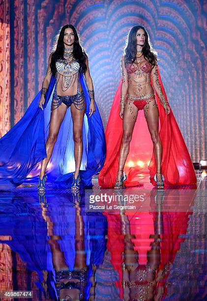 Alessandra Ambrosio and Adriana Lima walk the runway at the annual Victoria's Secret fashion show at Earls Court on December 2 2014 in London England