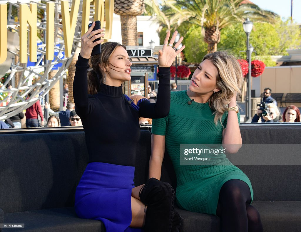 Alessandra Ambrosio (L) and Charissa Thompson talk about taking selfies at 'Extra' at Universal Studios Hollywood on December 2, 2016 in Universal City, California.