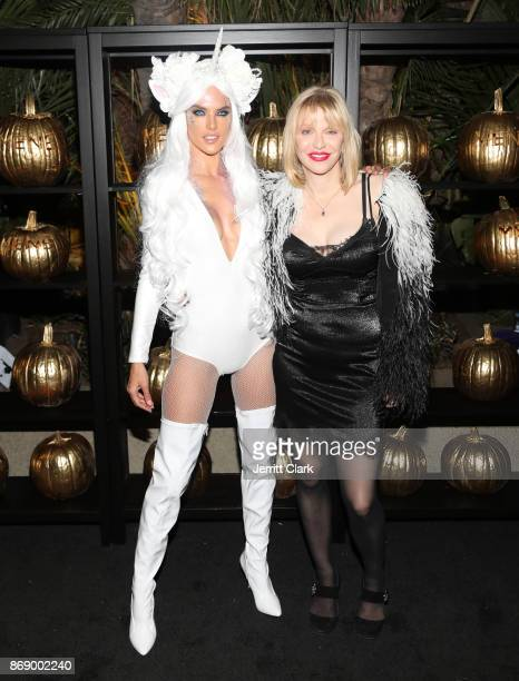 Alessandra Ambrosio and Courtney Love attend Darren Dzienciol and Alessandra Ambrosio's Halloween Bash on October 31 2017 in Los Angeles California