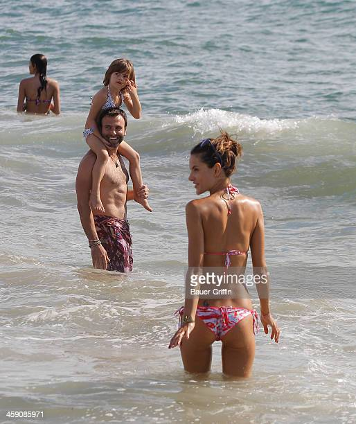 Alessandra Ambrosio and husband Jamie Mazur with daughter Anja Louise Ambrosio Mazur at a Malibu beach on September 02 2013 in Los Angeles California