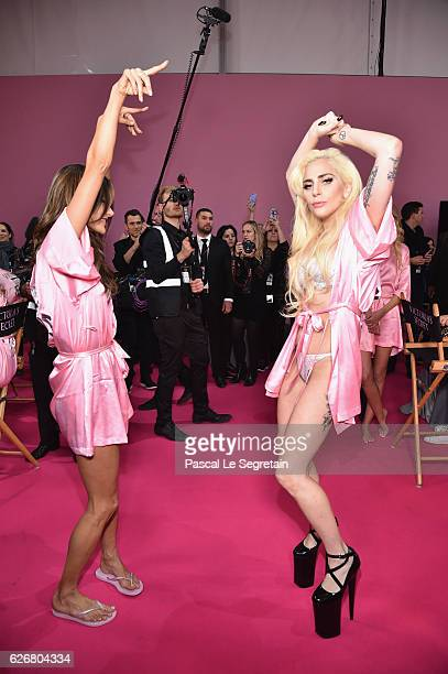 Alessandra Ambrosio and Lady Gaga dance backstage prior to the Victoria's Secret Fashion Show on November 30 2016 in Paris France