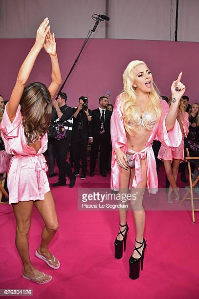 Alessandra Ambrosio and Lady Gaga dances backstage prior to the Victoria's Secret Fashion Show on November 30 2016 in Paris France