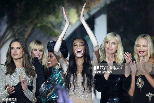 Alessandra Ambrosio and Winnie Harlow on stage at the amfAR Gala Cannes 2018 at Hotel du CapEdenRoc on May 17 2018 in Cap d'Antibes France