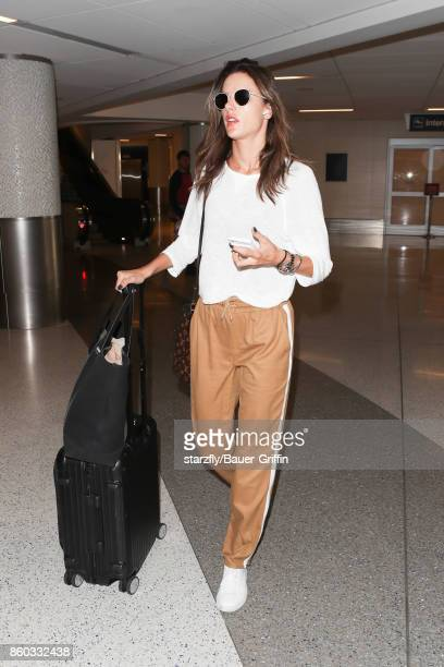 Alessandra Ambrosio is seen at LAX on October 11 2017 in Los Angeles California