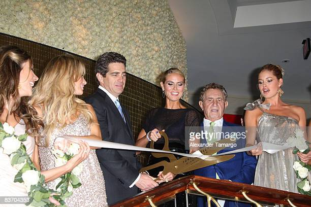 Alessandra Ambrosio Marissa Miller Jeff Soffer Heidi Klum Don Soffer and Doutzen Kroes cut the ribbon at the grand opening of Fontainebleau Miami...