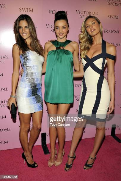 Alessandra Ambrosio Miranda Kerr and Candice Swanepoel pose for a picture at the 15th Anniversary of Victoria's Secret SWIM catalogue held at...