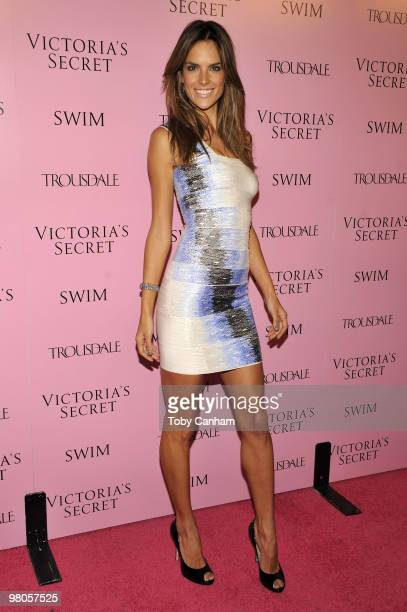Alessandra Ambrosio poses for a picture at the 15th Anniversary of Victoria's Secret SWIM catalogue held at Trousdale on March 25 2010 in Los Angeles...