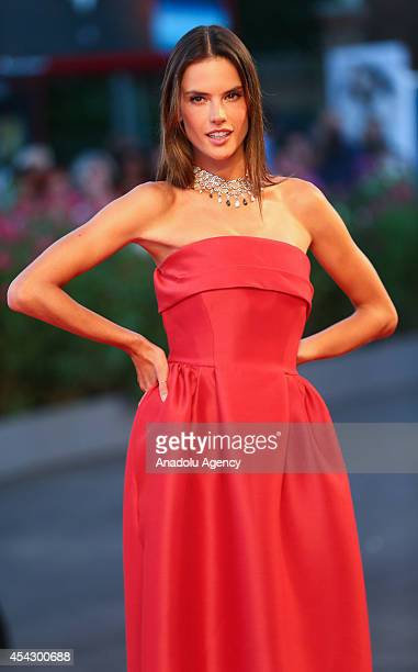 Alessandra Ambrosio poses to media with during gala of Xavier Beauvois' movie 'La Rancon De La Gloire' on the second day of the 71th Venice Film...