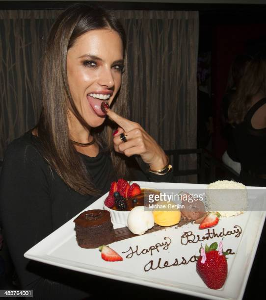 Alessandra Ambrosio presents a dessert at her Birthday Party at Koi Restaurant and Lounge on April 10 2014 in West Hollywood California