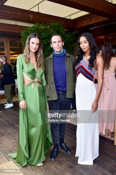 Alessandra Ambrosio, Sam Claflin, and Laura Harrier attend the Audi Design Loft Opening Celebration on August 11, 2021 in Malibu, California.