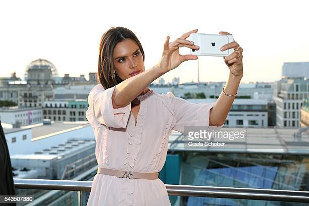 Alessandra Ambrosio taking a selfie during the after party of the Marc Cain fashion show spring/summer 2017 at China Club on June 28 2016 in Berlin...