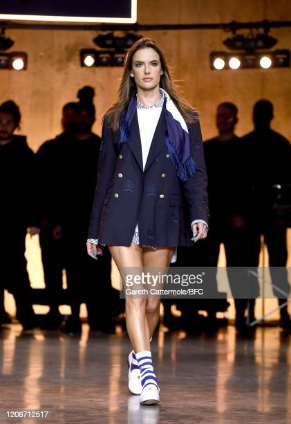 Alessandra Ambrosio walks the runway at the TommyNow show during London Fashion Week February 2020 at the Tate Modern on February 16, 2020 in London,...
