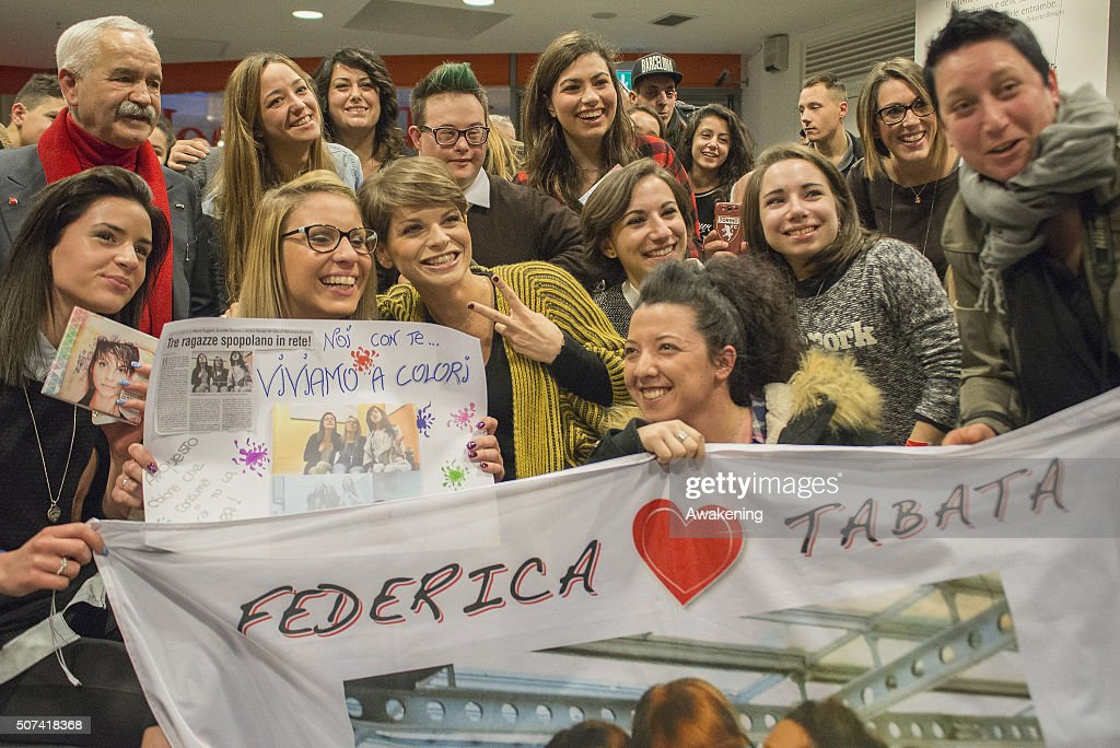 Alessandra Amoroso poses with fans during the presentation of 'Vivere a Colori' on January 29, 2016 in Turin, Italy.
