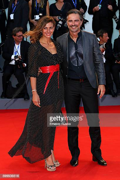 Alessandra Carrillo and Beppe Convertini attend the premiere of 'Jackie' during the 73rd Venice Film Festival at Sala Grande on September 7 2016 in...