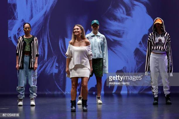 Alessandra Cirmia acknowledges the audience's applause on the runway after her show 'Hip Hop Femme' at the AMD Exit17_2 show during Platform Fashion...