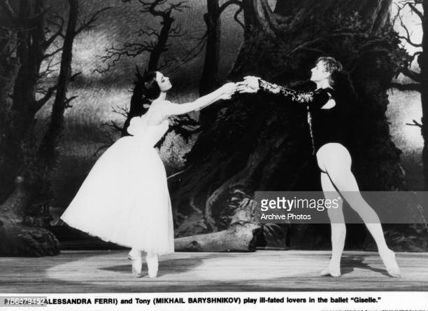 Alessandra Ferri dances onstage with Mikhail Baryshnikov in a scene from the film 'Dancers' 1987