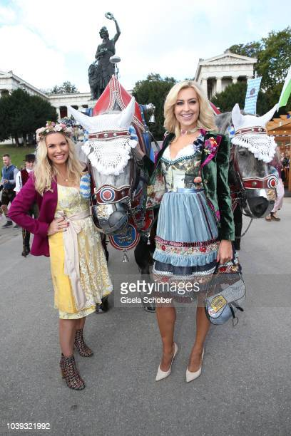 Alessandra Geissel and Verena Klein wearing a Dirndl by Lola Paltinger during the 'Sixt Damen Wiesn' as part of the Oktoberfest 2018 at...