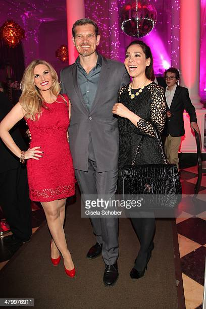 Alessandra Geissel Goetz Otto Sandra Ahrabian attend the AMREF Charity Gala 'Come Fly With Us' at Rilano No 6 on March 21 2014 in Munich Germany