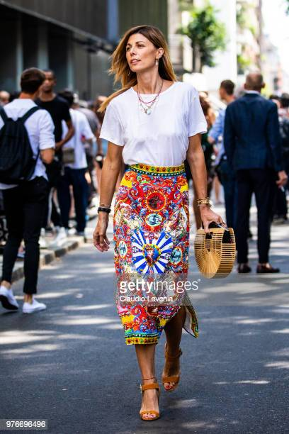 Alessandra Grillo wearing Dolce Gabbana skirt and wood bag is seen in the streets of Milan after the Dolce Gabbana show during Milan Men's Fashion...