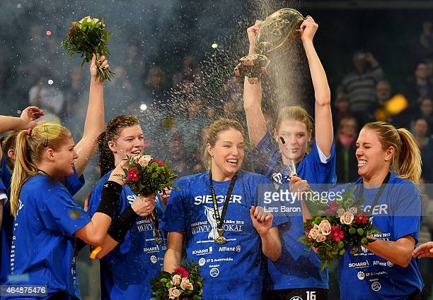Alessandra JovyHeuser of Stuttgart lifts the trophy and celebrates with team mates after winnning the German Women Cup Final between Ladies in Black...