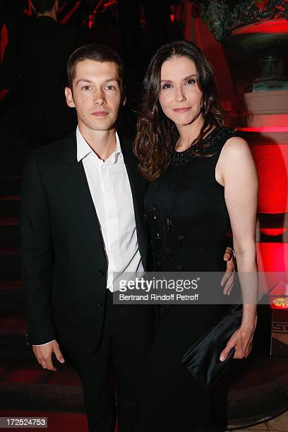 Alessandra Martines and Cyril Descours attend 'Lancome show by Alber Elbaz' Party at Le Trianon on July 2 2013 in Paris France