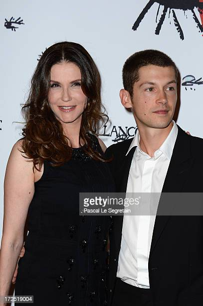 Alessandra Martines and her son Cyril Descours attend the 'Lancome Show By Alber Elbaz' Party at Le Trianon on July 2 2013 in Paris France
