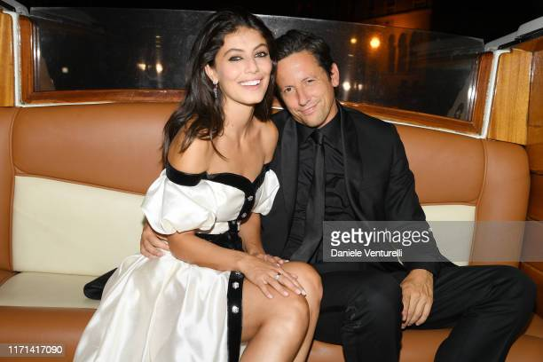 Alessandra Mastronardi and Ross McCall arrive by taxi boat to the Vanity Fair Black And White Ball Photocall during the 76th Venice Film Festival at...