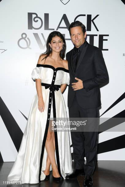 Alessandra Mastronardi and Ross McCall attends the Vanity Fair Black And White Ball Photocall during the 76th Venice Film Festival at Scuola Grande...