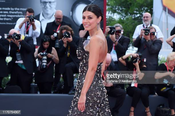 Alessandra Mastronardi walks the red carpet ahead of the Opening Ceremony and the La Vérité screening during the 76th Venice Film Festival at Sala...
