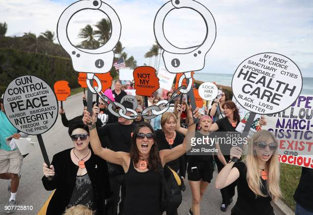 Alessandra Mondolfi and other people protest against President Donald Trump on the one year anniversary of his inauguration on January 20 2018 in...