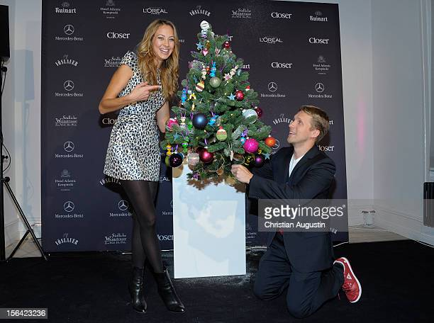 Alessandra Pocher and Oliver Pocher show a decorated Christmas Tree during the Charity Event SMILE for the magazine Closer on November 14 2012 in...