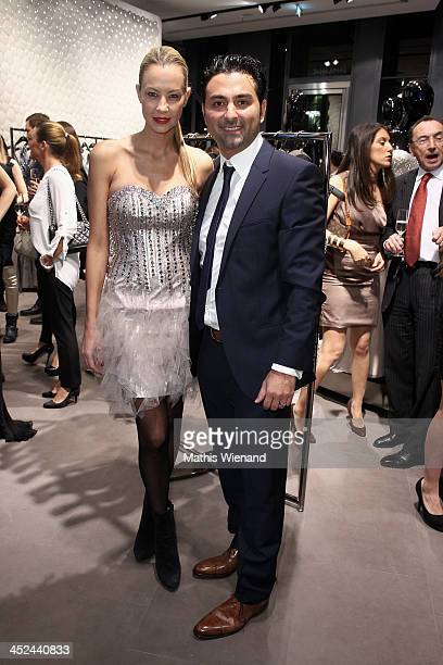 Alessandra Pocher and Shahin Moghadam attend the Unique Flagship Store Opening at the new 'Koe Bogen' on November 28 2013 in Duesseldorf Germany