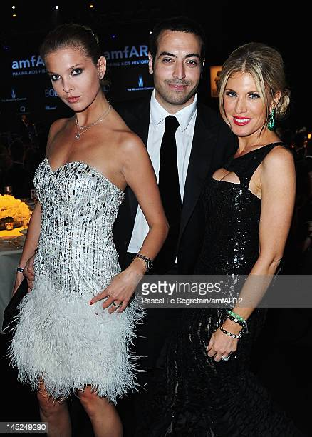 Alessandra Pozzi Mohammed Al Turki and Hofit Golan attend the 2012 amfAR's Cinema Against AIDS during the 65th Annual Cannes Film Festival at Hotel...