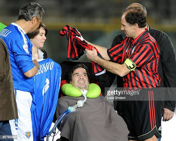 Alessandro Altobelli and Franco Baresi greet Stefano Borgonovo before the charity football match between Milan Glorie and Brescia Glorie at the...