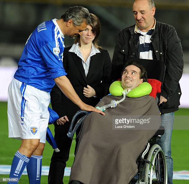 Alessandro Altobelli greets Stefano Borgonovo before the charity football match between Milan Glorie and Brescia Glorie at the Rigamonti stadium on...