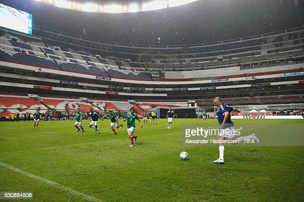 Alessandro Altobelli of FIFA Legends battles for the ball during an exhibition match between FIFA Legends and MexicanAllstars to celebrate the 50th...