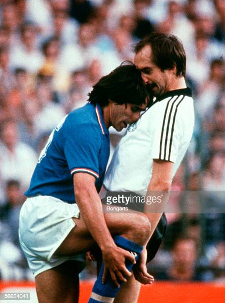 Alessandro Altobelli of Italy clash with Uli Stielike of Germany during the World Cup final match between Italy and Germany on July 11, 1982 in...