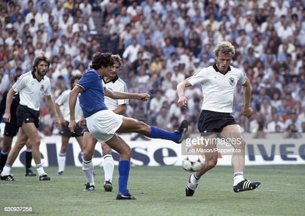 Alessandro Altobelli of Italy shoots past HansPeter Briegel of West Germany during the FIFA World Cup Final between Italy and West Germany at the...