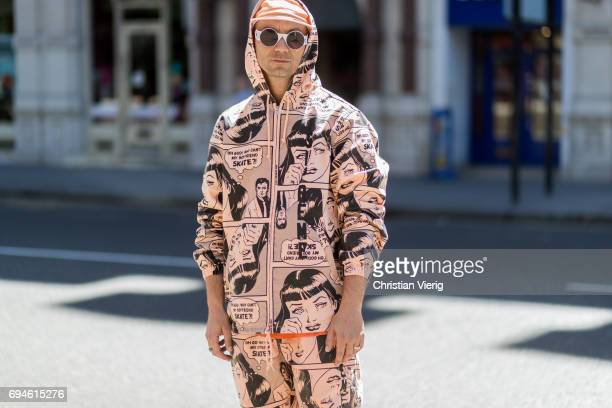 Alessandro Altomare wearing a hooded suit with print and cap during the London Fashion Week Men's June 2017 collections on June 10 2017 in London...
