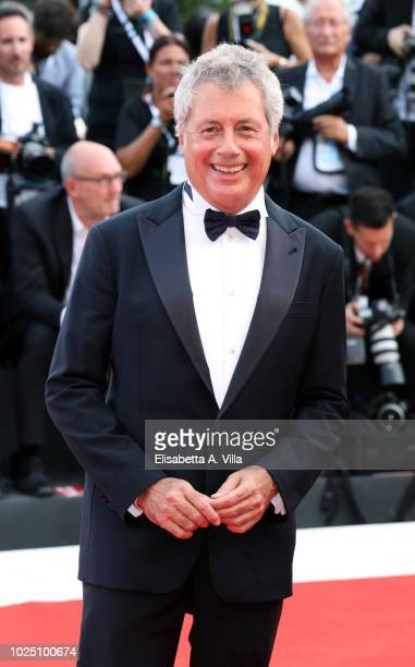 Alessandro Baricco walks the red carpet ahead of the opening ceremony and the 'First Man' screening during the 75th Venice Film Festival at Sala...