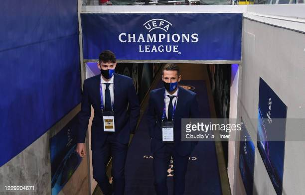 Alessandro Bastoni and Andrea Pinamonti of FC Internazionale attend prior to the UEFA Champions League Group B stage match between FC Internazionale...