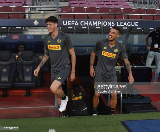 Alessandro Bastoni and Cristiano Biraghi of FC Internazionale look on during a FC Internazionale training session on October 1, 2019 in Barcelona,...