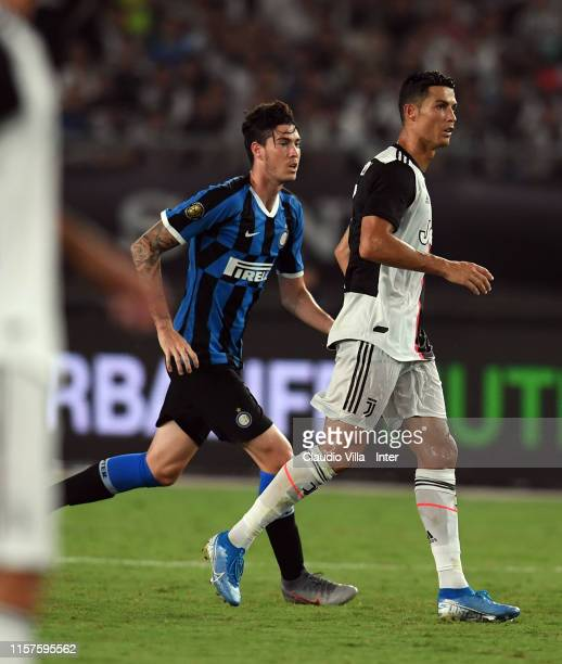 Alessandro Bastoni of FC Internazionale and Cristiano Ronaldo of Juventus compete for the ball during the International Champions Cup match between...