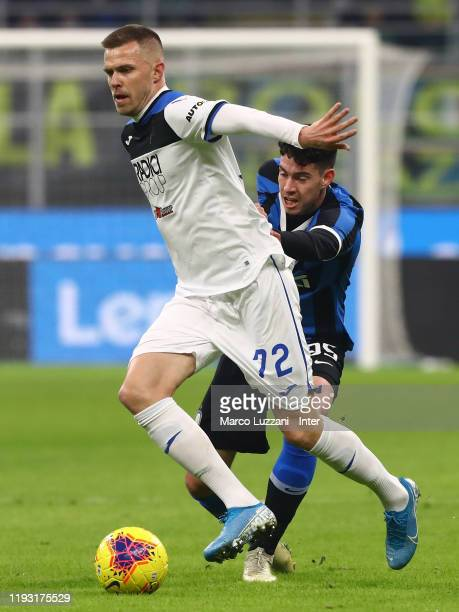 Alessandro Bastoni of FC Internazionale competes for the ball with Josip Ilicic of Atalanta BC during the Serie A match between FC Internazionale and...