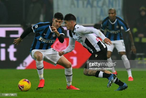 Alessandro Bastoni of FC Internazionale competes for the ball with Rodrigo De Paul of Udinese Calcio during the Serie A match between Udinese Calcio...